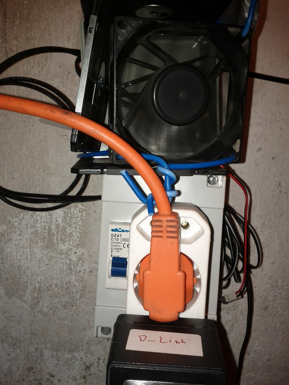 controller with orange extension cord plugged in